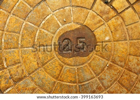 Background metal plate with 25 written on it - stock photo