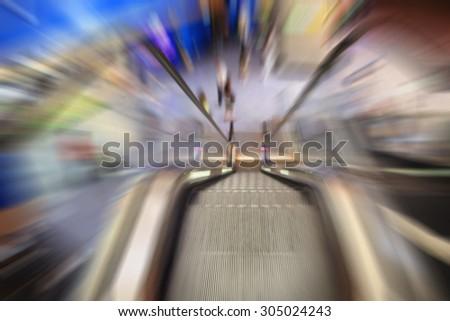 background moving escalator in shopping center - stock photo
