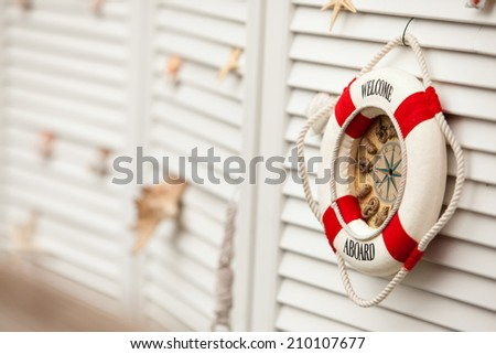 Background nautical image of a welcome aboard sign - stock photo