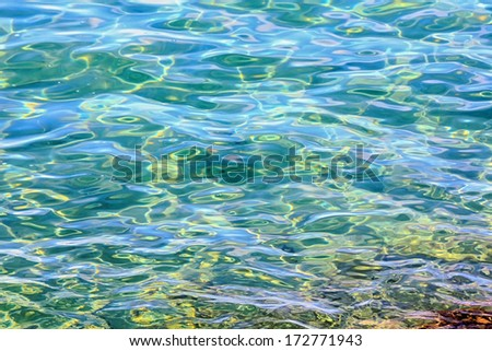 Background Navy textured waves on calm sea - stock photo