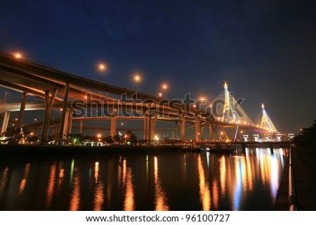 Background  night landscape of Bhumibol, aka Industrial Ring road, bridge and reservoir near Chao Phraya river in Bangkok, Thailand - stock photo
