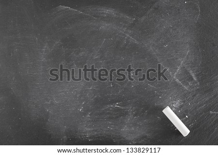 Background of a black board with single piece of chalk - stock photo