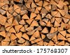 Background of a stack of split logs in a woodpile for use as domestic heating in winter with a close up view of the cross-section at the ends - stock photo