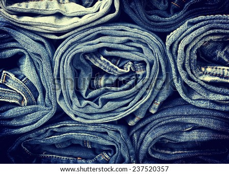 background of a stack rolled jeans (vintage) - stock photo