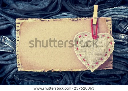 background of a stack rolled jeans with space for text (vintage) - stock photo
