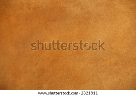 background of a warm brown wall with rough plaster texture - stock photo