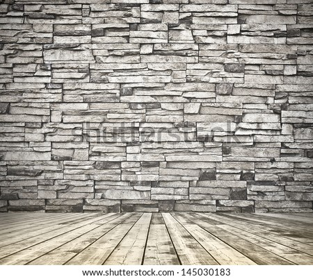 Background of aged grungy textured black brick and stone wall with light wooden floor with whiteboard inside old neglected and deserted empty interior, blank horizontal space of clean studio room - stock photo