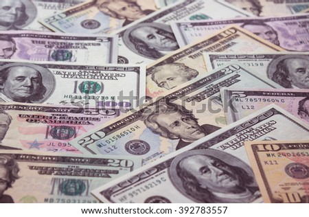Background of American 5, 10, 20, 50, 100 dollar banknotes, close up view of cash money dollars bills in amount  - stock photo