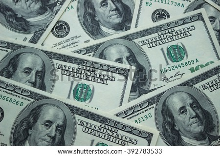 Background of American 100 dollar banknotes, close up view of cash money dollars bills in amount - stock photo
