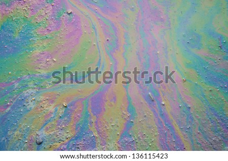 Background of an oil slick on the asphalt. - stock photo