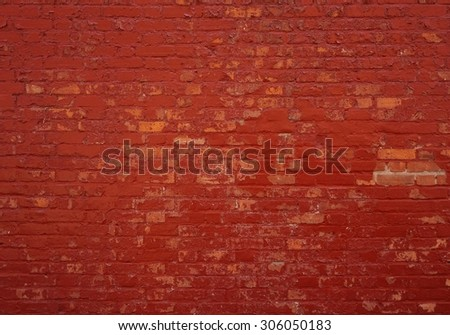 Background of an old brick wall with red stones - stock photo