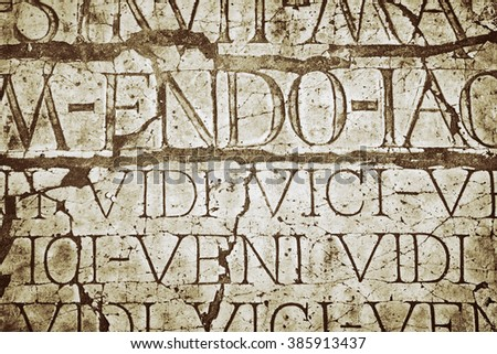 Background of an Old Cracked Wall  with Latin Inscriptions - stock photo