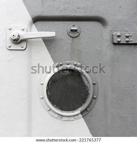 Background of an old ship metal door with a round window - stock photo