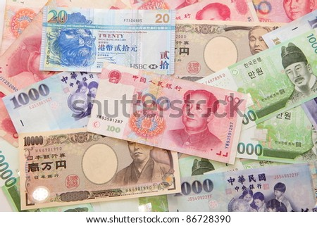 Background of asian currency (include Korean Won, Taiwan dollar, Chinese Money yuan , Hong Kong Dollar, japanese Yen) - stock photo