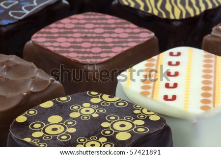 background of  assorted decorated luxury chocolate bonbons - stock photo