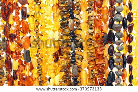 Background of baltic amber necklaces - stock photo