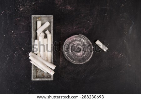 Background of blackboard with pieces of chalk to artistic use - stock photo