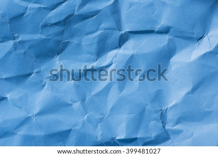 Background of blue empty wrinkled paper. Backdrop texture with copyspace and rough rumple surface. - stock photo