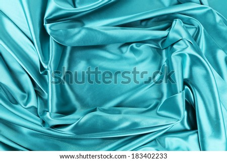 Background of blue fabric and rectangle. Whole background. - stock photo