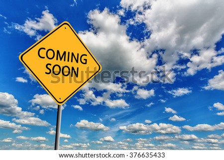 Background of blue sky with cumulus clouds and yellow sign - stock photo