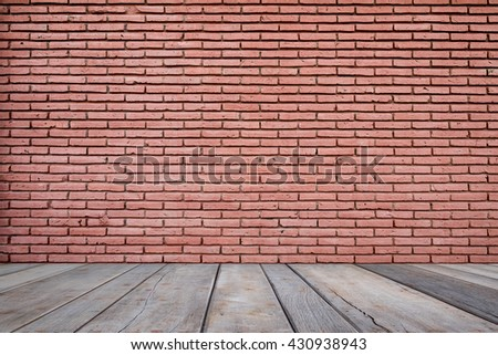 Background of brick wall texture on wooden floor. - stock photo