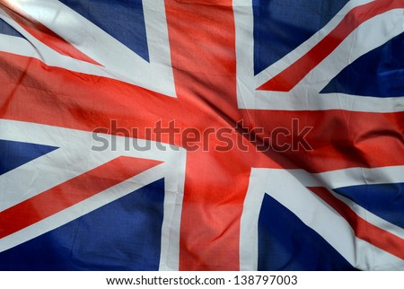 Background Of British Union Jack Flag In The Wind - stock photo