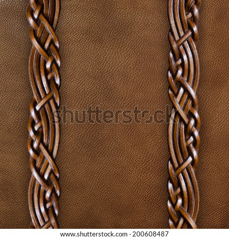 Background of brown leather with braided leather straps - stock photo