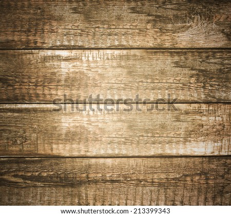Background of brown old natural wood planks Dark aged empty rural room with tree floor pattern texture Closeup view to golden surface of retro pine logs inside vintage light warm interior with shadows - stock photo