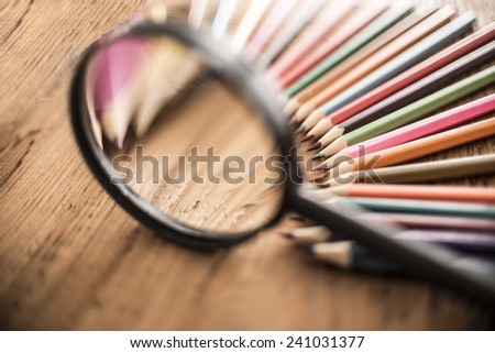 background of bunch of pencil under magnifying glass on wood table Idea of concentration and attraction to nucleus center circle radius unity concept of leadership, community, team focused on one goal - stock photo