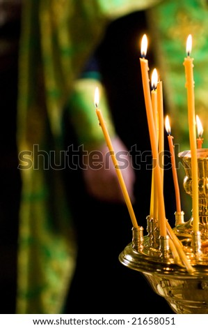 background of burning candles in the orthodox church - stock photo
