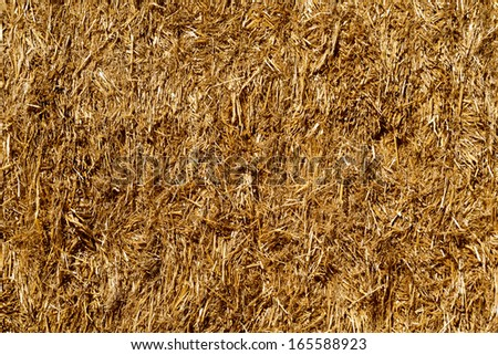 background of close up golden square haystack bale - stock photo