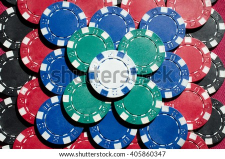 Background of Close up of different poker chips  - stock photo