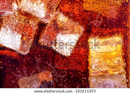 Background of cola with ice and bubbles - stock photo