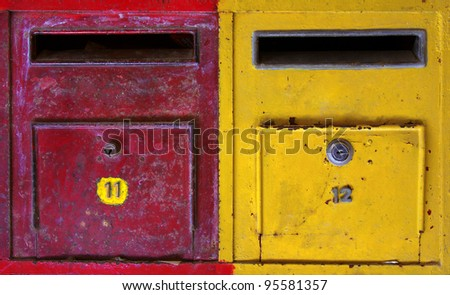 background of colorful old and rusty mailboxes - stock photo
