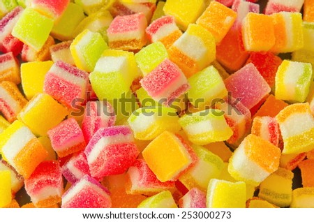 Background of colorful sprinkles, jelly for cake decoration or ice cream topping - stock photo