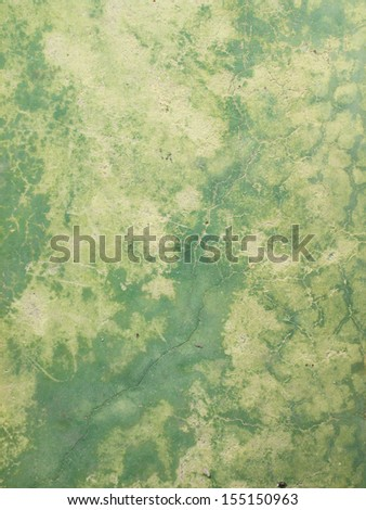 background of cracked old green cement wall - stock photo