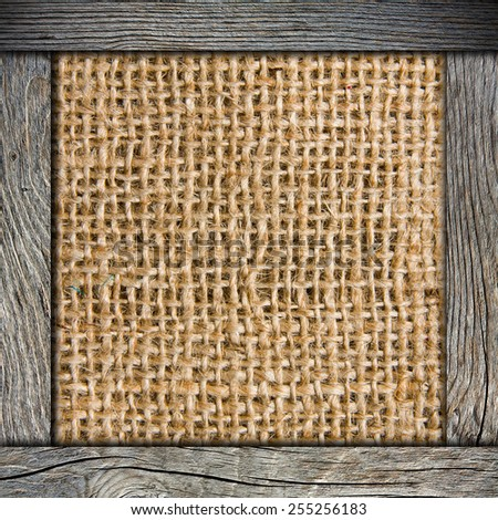Background of crumpled burlap with wood frame - stock photo