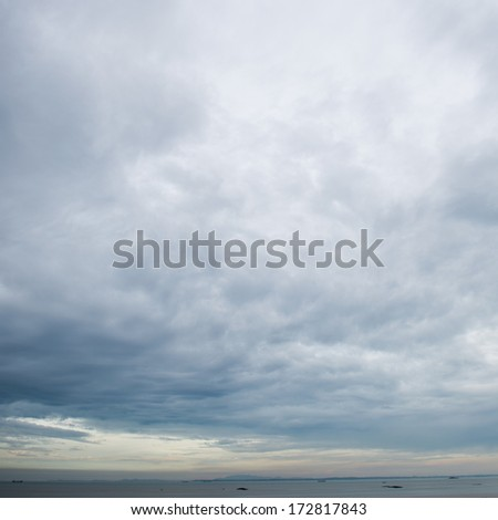 Background of dark clouds before a thunder-storm - stock photo