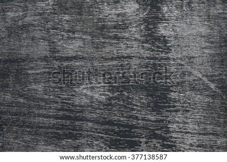 Background of dark weathered wood texture with peeling black paint showing grey woodgrain - stock photo