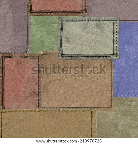 background of different color empty leather labels - stock photo