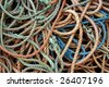 Background of dirty old fishing ropes under sunlight - stock photo