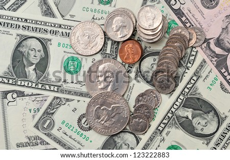 Background of dollar banknotes and coins, with selective focus. - stock photo