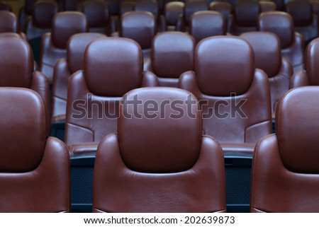 Background of Empty Cinema Chairs in Rows - stock photo