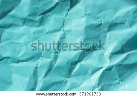 Background of empty wrinkled green paper. Backdrop texture with copyspace and rough rumple surface. - stock photo