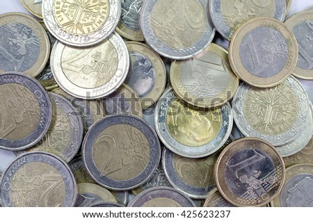 background of euro coins including one euro and two euros - stock photo
