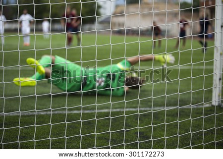 background of football goalkeeper  jumping for the ball - stock photo