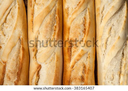 Background of French baguettes. Shot from above. - stock photo