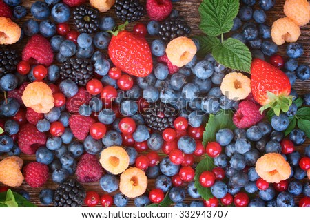 background of fresh colorful  berries mix, top view, retro toned - stock photo