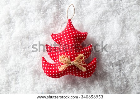 Background of fresh snow with Christmas decoration, Christmas decoration in snow. - stock photo