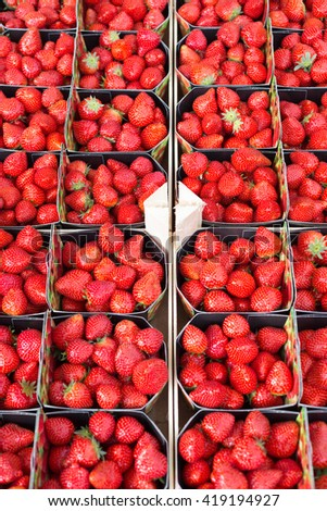Background of fresh strawberries in boxes. - stock photo